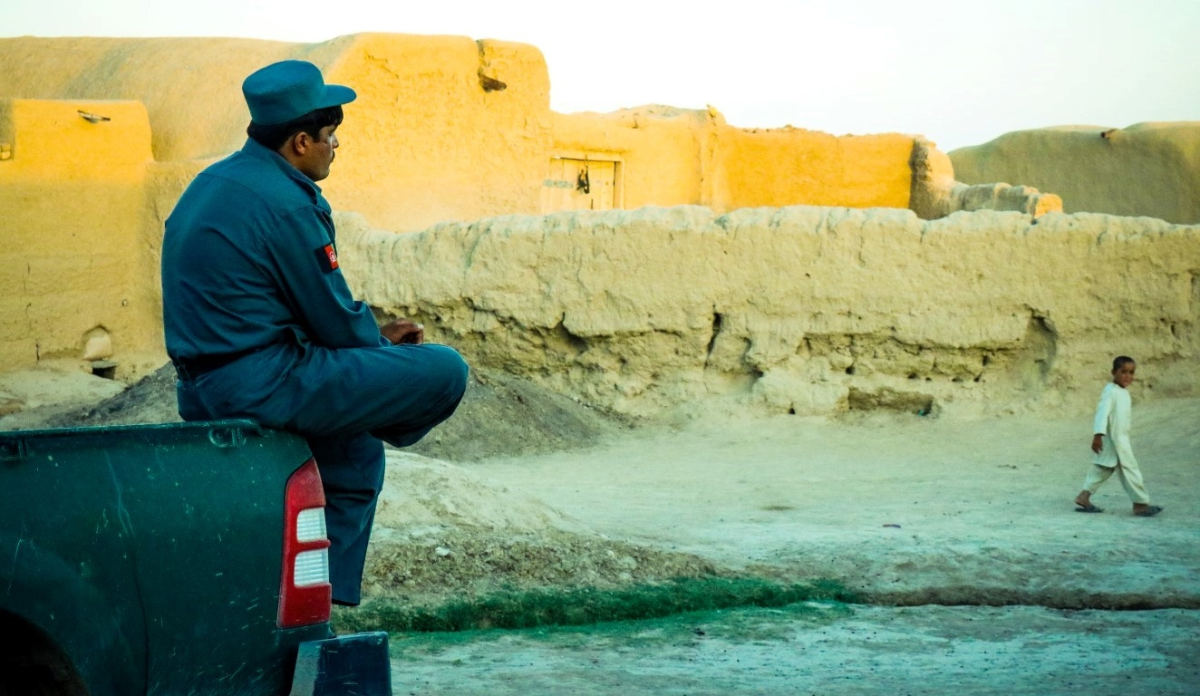 An-afghan-policeman-watching-the-sunset-in-Mowmand-village